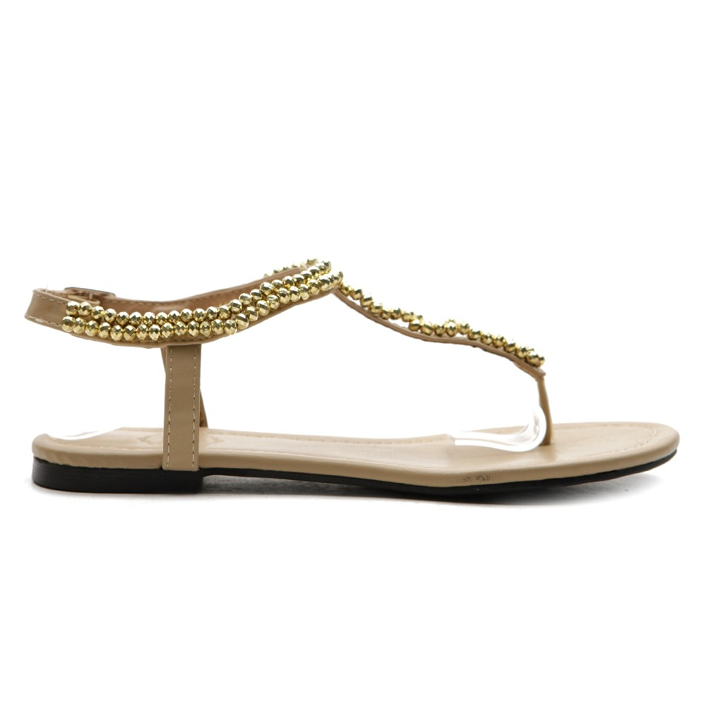 Model A Pair Of Donald J Pliner Beaded Sandals The Thong Sandals Have A Beaded Butterfly Design Across Each Strap The Sandals Are A Womens Size 9 And Feature A Small Kitten Heel The Shoes Comes In Their Original Protective Dust Bag